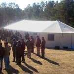 Briefing in front of Western Shelter 23' x 60' tent